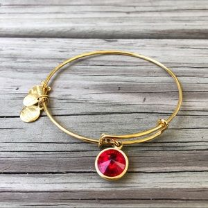 Alex and Ani gold colored ruby bracelet